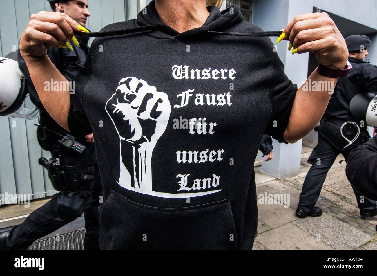 Dortmund, Nordrhein Westfalen, Germany. 25th May, 2019. ''Our fists for our land'' worn by a neonazi in Dortmund, Germany. Prior to the European Elections, the neonazi party Die Rechte (The Right) organized a rally in the German city of Dortmund to promote their candidate, the incarcerated Holocaust denier Ursula Haverbeck. The demonstration and march were organized by prominent local political figure and neonazi activist Michael Brueck (Michael Brück) who enlisted the help of not only German neonazis, but also assistance from Russian, Bulgarian, Hungarian, and Dutch groups with the final t Stock Photo