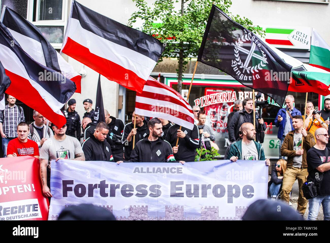 Dortmund, Nordrhein Westfalen, Germany. 25th May, 2019. The Alliance Fortress Europe consisting of German, French, Bulgarian, and Hungarian neonazis as seen in Dortmund, Germany. Prior to the European Elections, the neonazi party Die Rechte (The Right) organized a rally in the German city of Dortmund to promote their candidate, the incarcerated Holocaust denier Ursula Haverbeck. The demonstration and march were organized by prominent local political figure and neonazi activist Michael Brueck (Michael Brück) who enlisted the help of not only German neonazis, but also assistance from Russian, Stock Photo