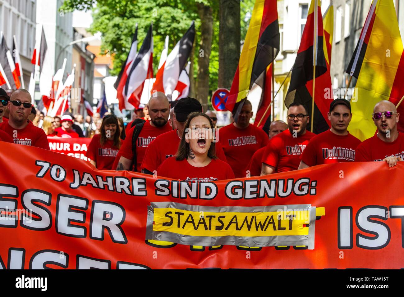 Dortmund, Nordrhein Westfalen, Germany. 25th May, 2019. Neonazis in Dortmund, Germany chant slogans through the streets of the city. Prior to the European Elections, the neonazi party Die Rechte (The Right) organized a rally in the German city of Dortmund to promote their candidate, the incarcerated Holocaust denier Ursula Haverbeck. The demonstration and march were organized by prominent local political figure and neonazi activist Michael Brueck (Michael Brück) who enlisted the help of not only German neonazis, but also assistance from Russian, Bulgarian, Hungarian, and Dutch groups with t Stock Photo