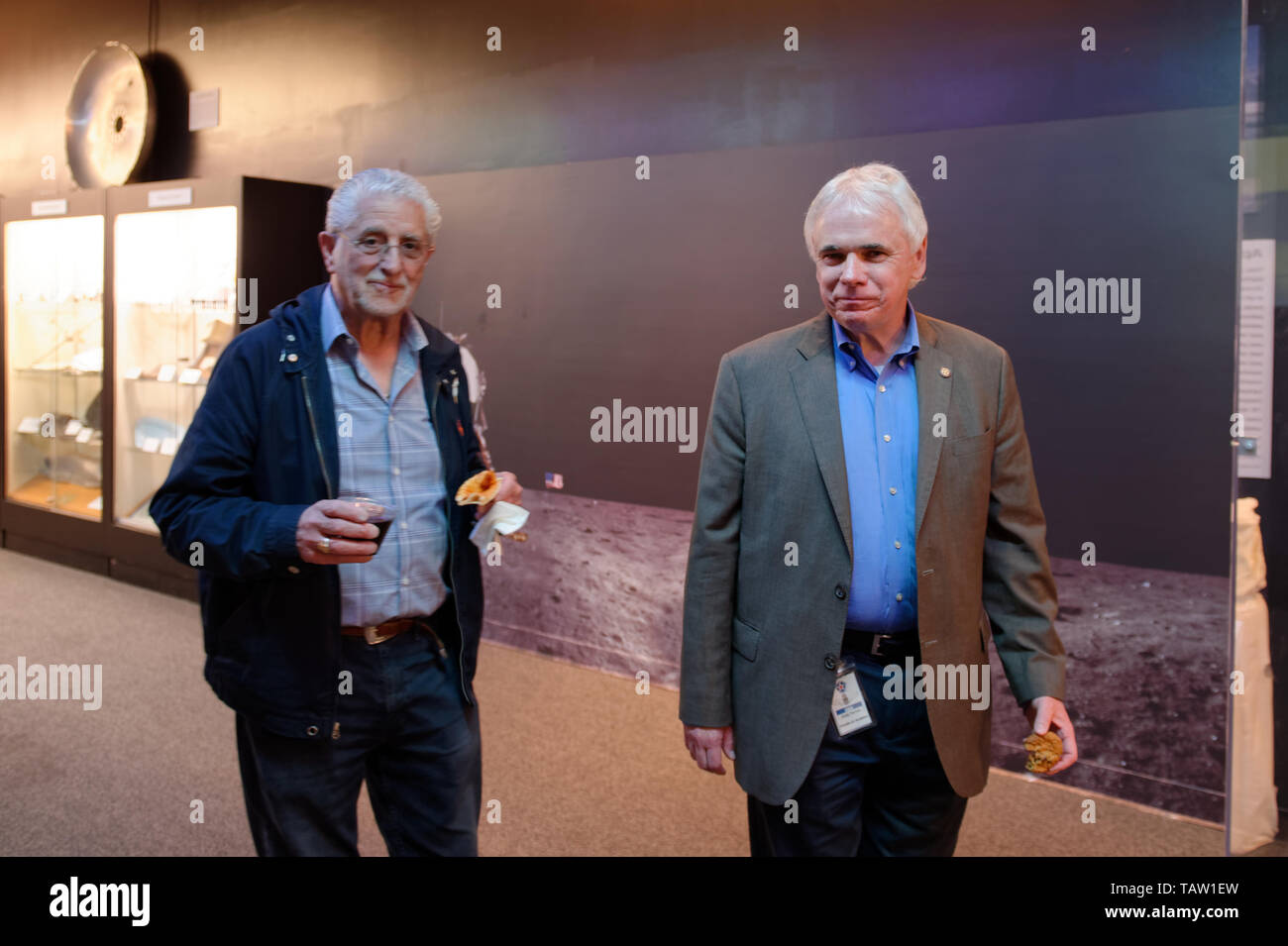 Garden City, New York, USA. 23rd May, 2019. At right, ANDREW PARTON, President of the Cradle of Aviation Museum, and a guest walk from a Reception to a talk during An Evening with Andrew Chaikin, an event that is part of the museum's celebration of 50th Anniversary of Apollo 11. Credit: Ann Parry/ZUMA Wire/Alamy Live News - Stock Image
