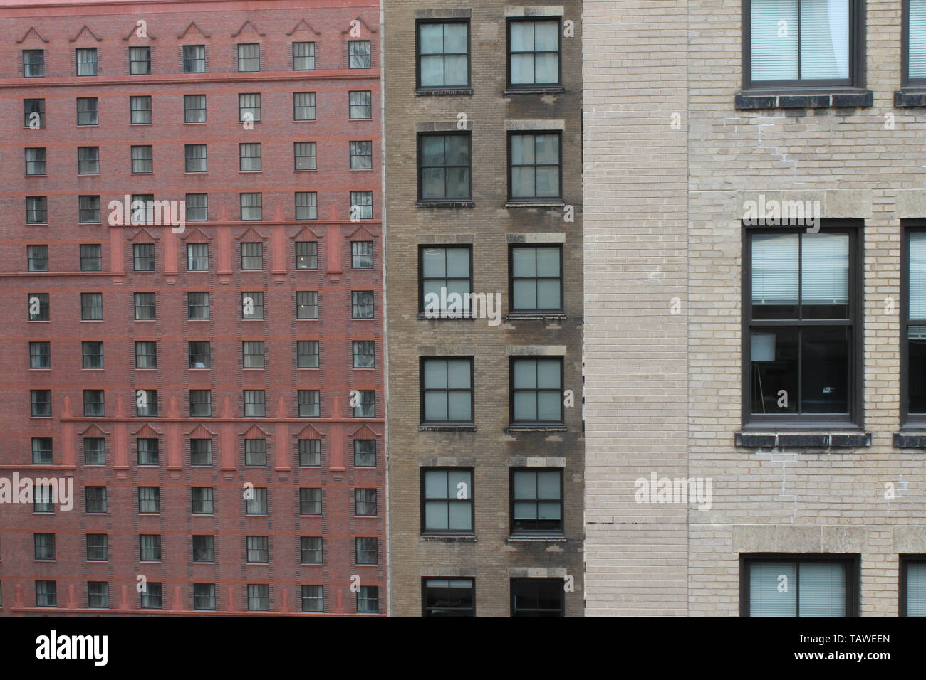 Three old brick buildings with lots of windows in downtown, the Loop, Chicago, Illinois, USA - Stock Image