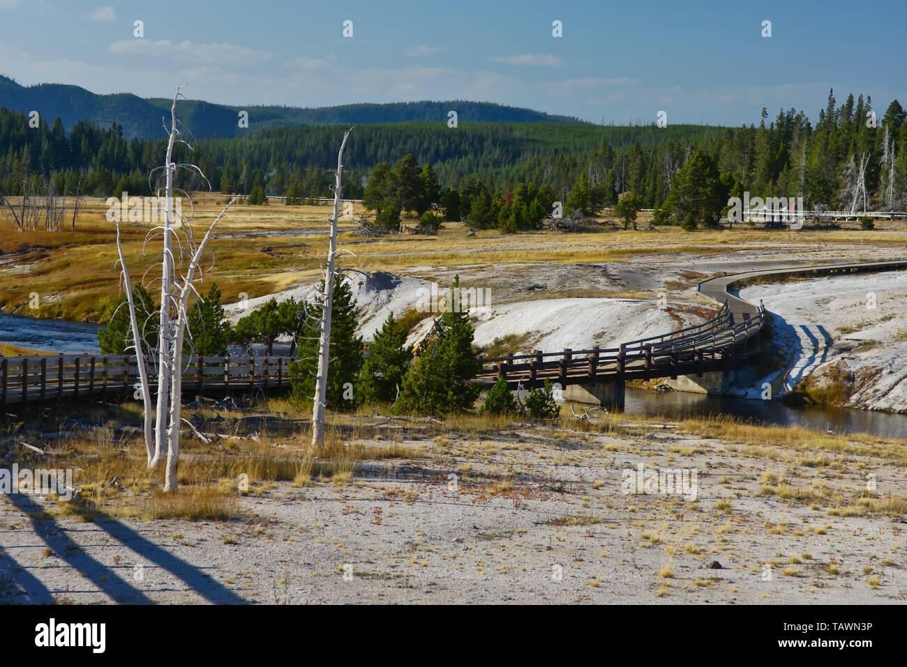 A walkway, bridge with wooden rails across Yellowstone river Stock Photo