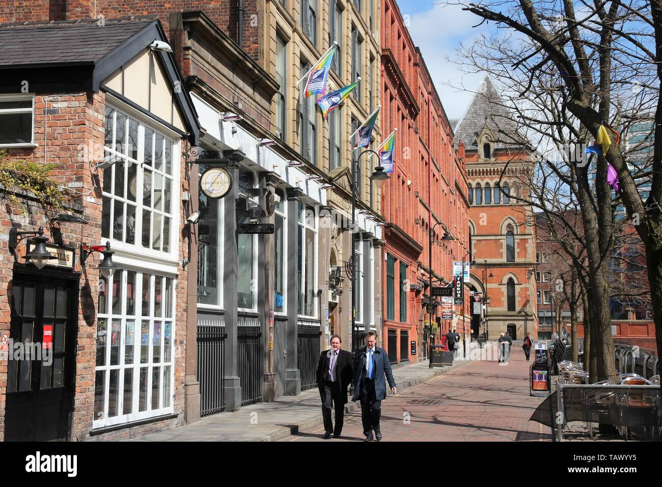 MANCHESTER, UK - APRIL 23, 2013: People visit famous Gay Village in Manchester, UK. Gay Village is one of oldest and largest LGBT related communities  - Stock Image