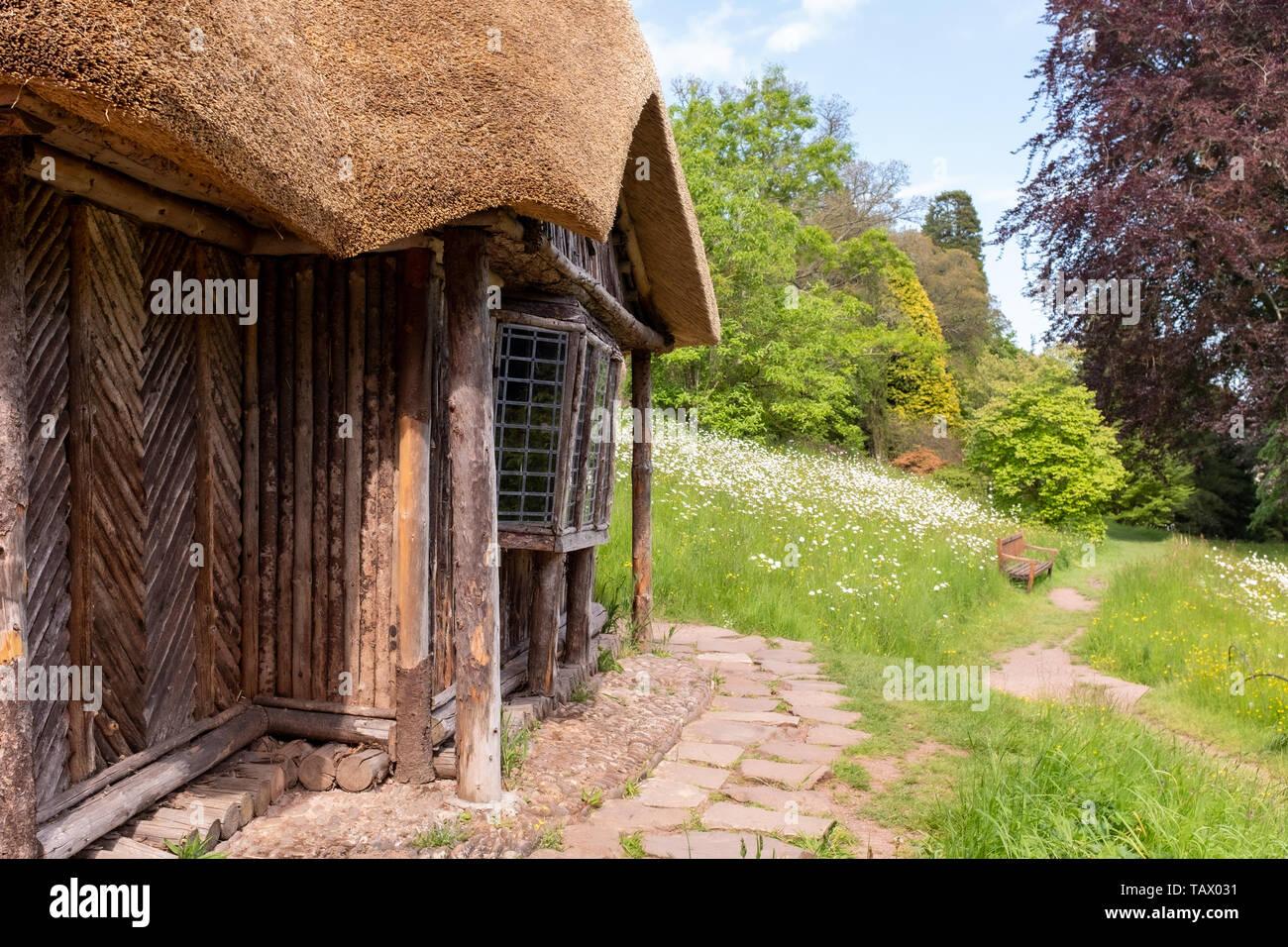The Bear's Hut, old thatched garden building, Killerton Estate, National Trust, Devon, UK Stock Photo