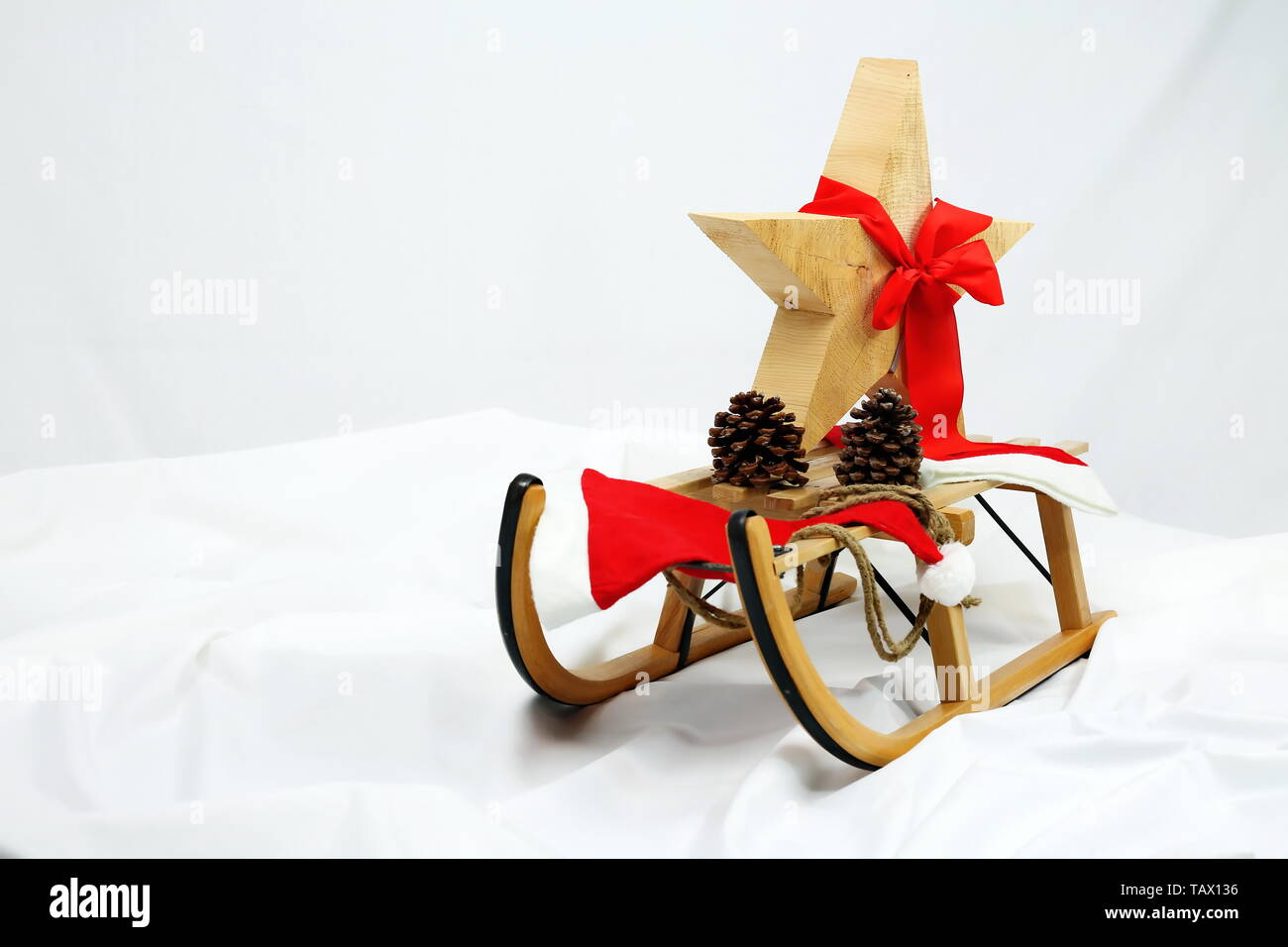 Christmas star decoration with red bow on a sledge Stock Photo