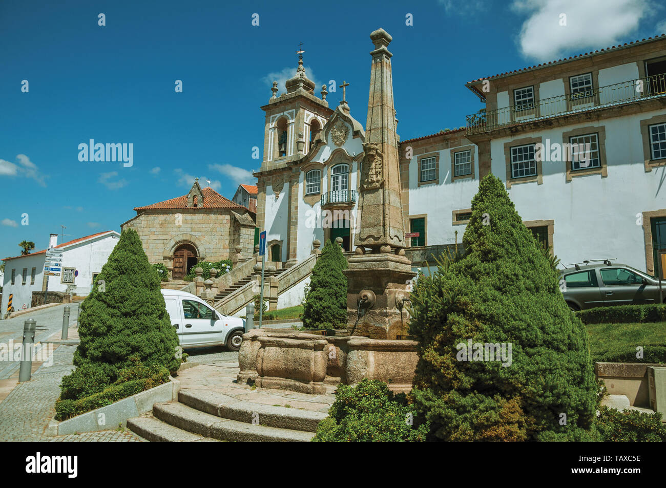 Baroque Church of the Misericordia in front of square with stone pillory at Seia. A nice village of Portugal also known for its delicious cheese. - Stock Image