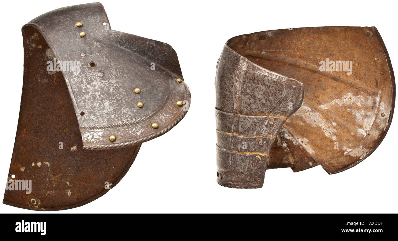Two etched Italian pauldrons, end of the 16th century, Chased iron, recessed ornamental scrolls with tendrils and trophies. Heights 19 and 20 cm. defensive arms, weapons, arms, weapon, arm, fighting device, object, objects, stills, clipping, clippings, cut out, cut-out, cut-outs, utensil, piece of equipment, utensils, historic, historical, Additional-Rights-Clearance-Info-Not-Available - Stock Image