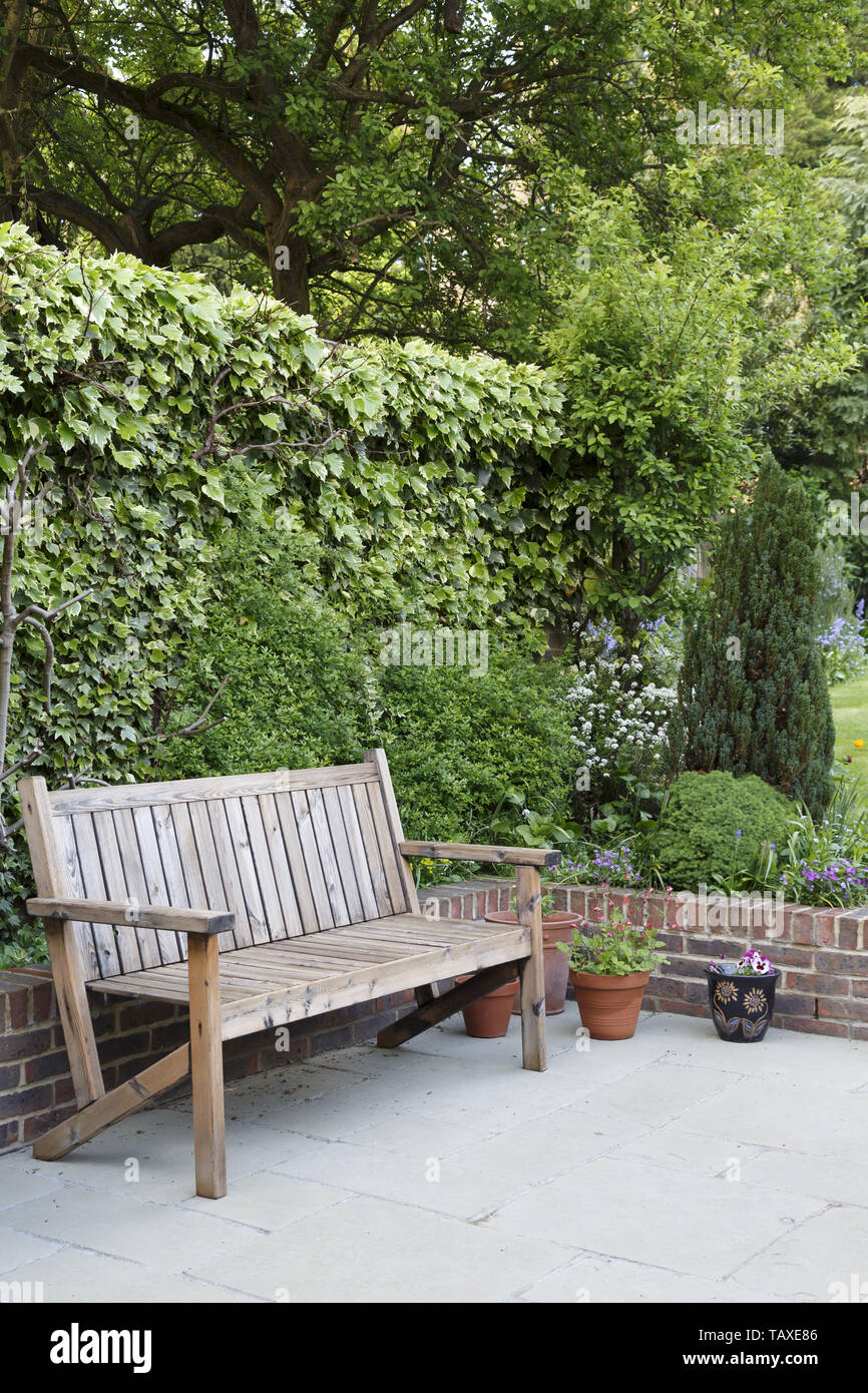 Admirable Wooden Garden Bench On A Patio In A Typical Suburban Back Machost Co Dining Chair Design Ideas Machostcouk