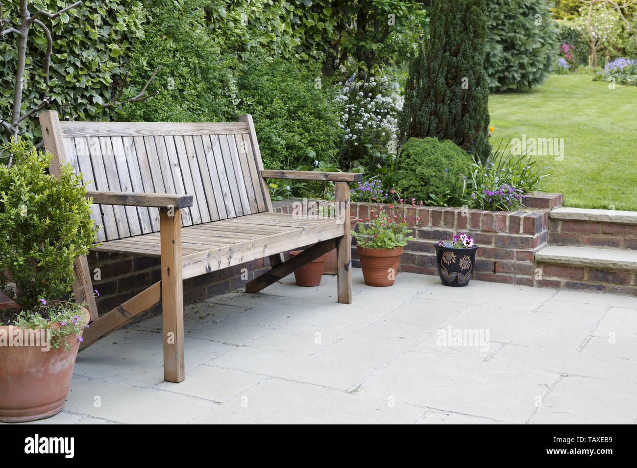 Brilliant British Back Garden With A Paved Patio And Traditional Machost Co Dining Chair Design Ideas Machostcouk