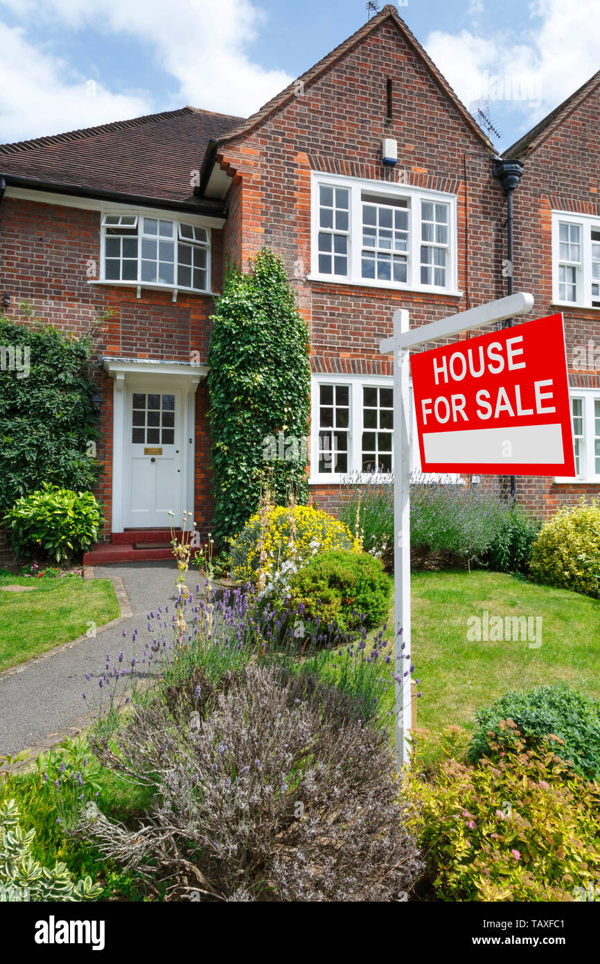 House for sale sign outside a typical UK semi-detached house in London - Stock Image