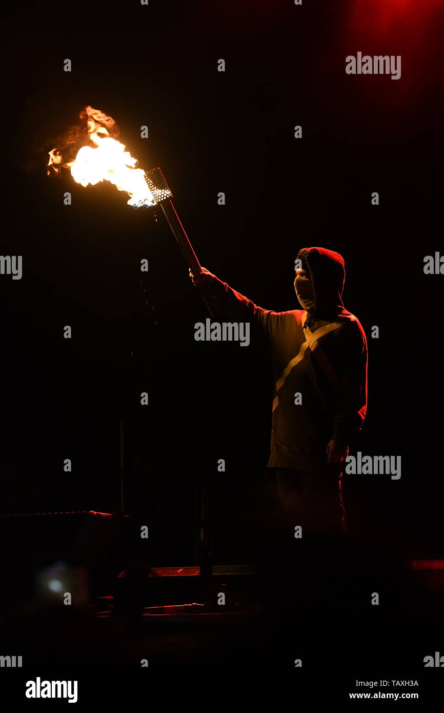 """Drummer Josh Dun is shown performing on stage during a """"live"""" stand up concert appearance with Twenty One Pilots. Stock Photo"""