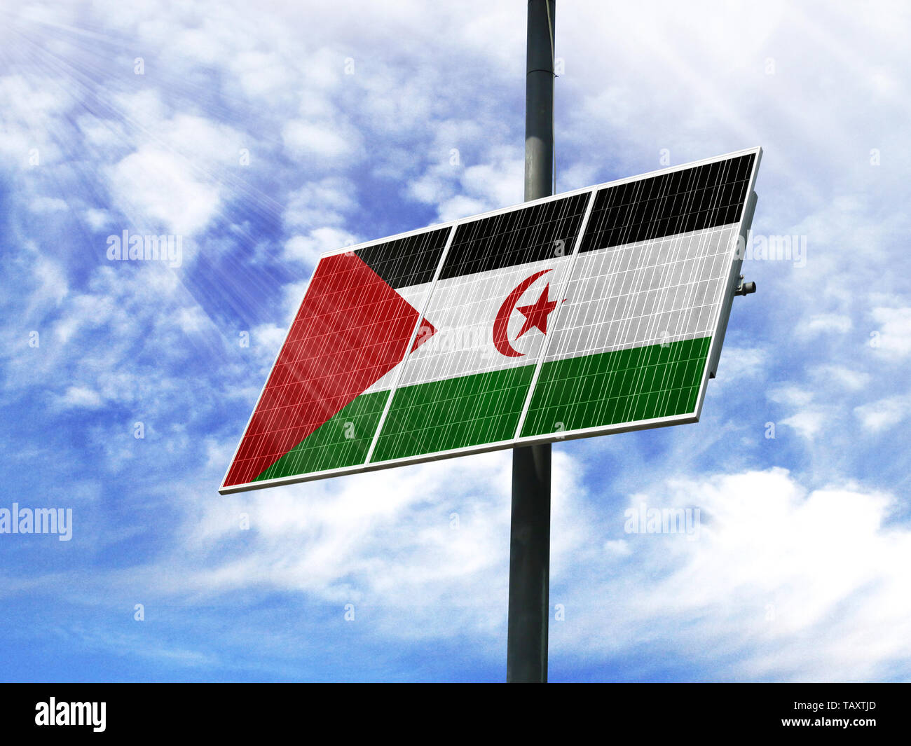 Solar panels against a blue sky with a picture of the flag of Western Sahara - Stock Image