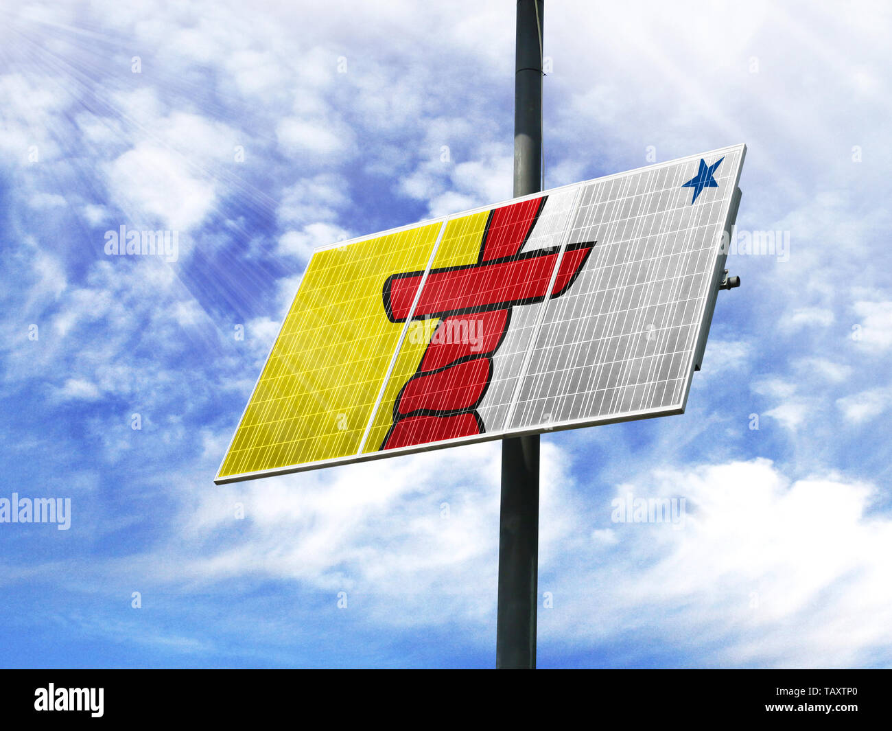 Solar panels against a blue sky with a picture of the flag of Nunavut - Stock Image