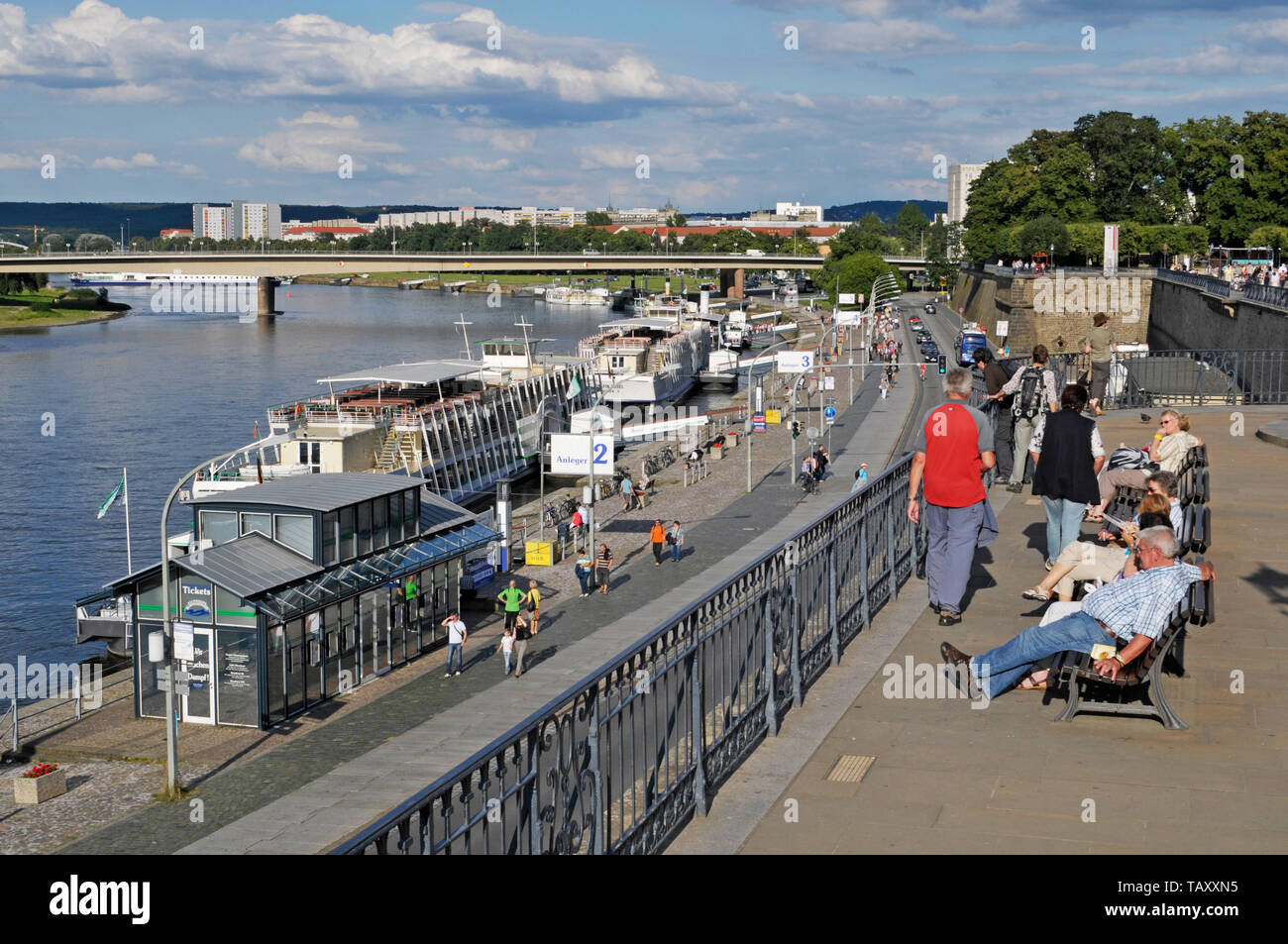 people on benches at Bruehl's Terrace over Terrassenufer waterfront, Dresden, Germany Stock Photo