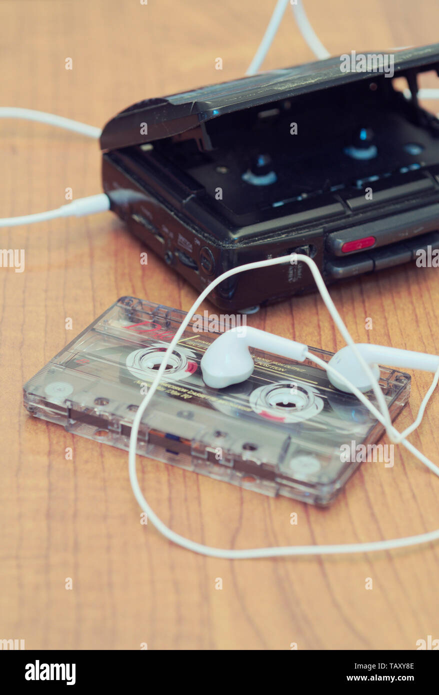 cassette player with earbuds and tape cassette - Stock Image