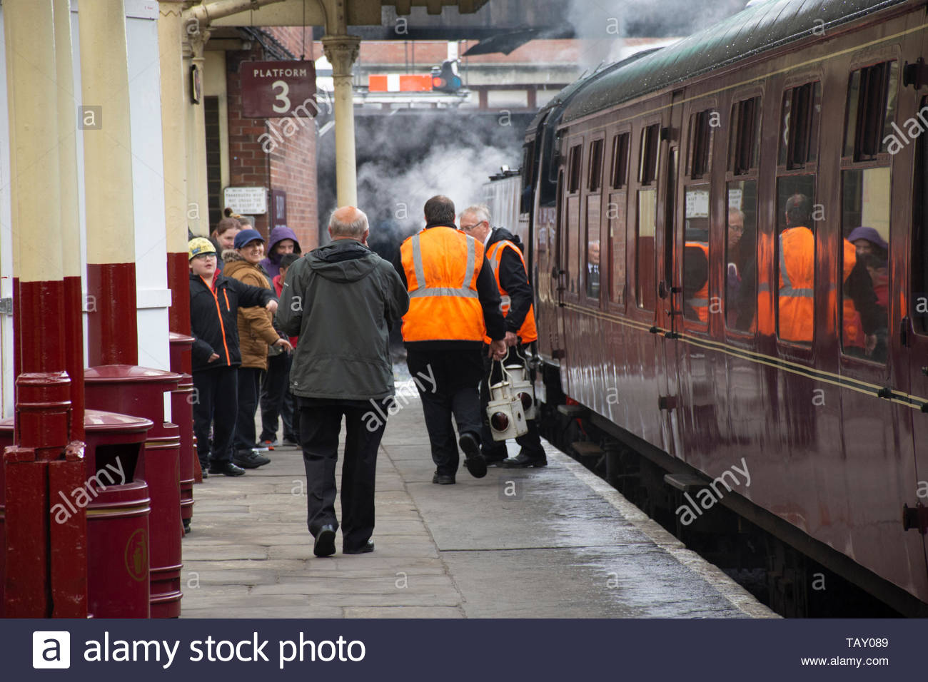 Staff and passengers on the plaform at the East Lancs Railway, a heritage line in Bury, Lancashire, UK - Stock Image