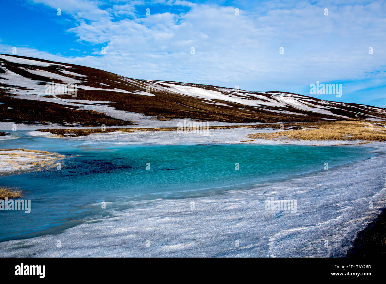 Blue green ice lake in the highlands in the winter of Iceland Stock Photo