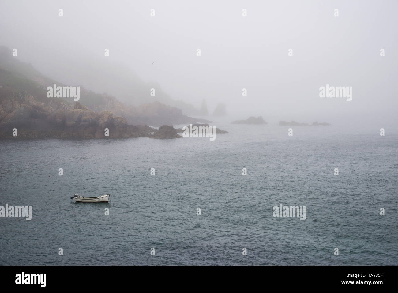 Sea fret rolling in over Saints Bay harbour - Guernsey, Channel Islands (UK) Stock Photo
