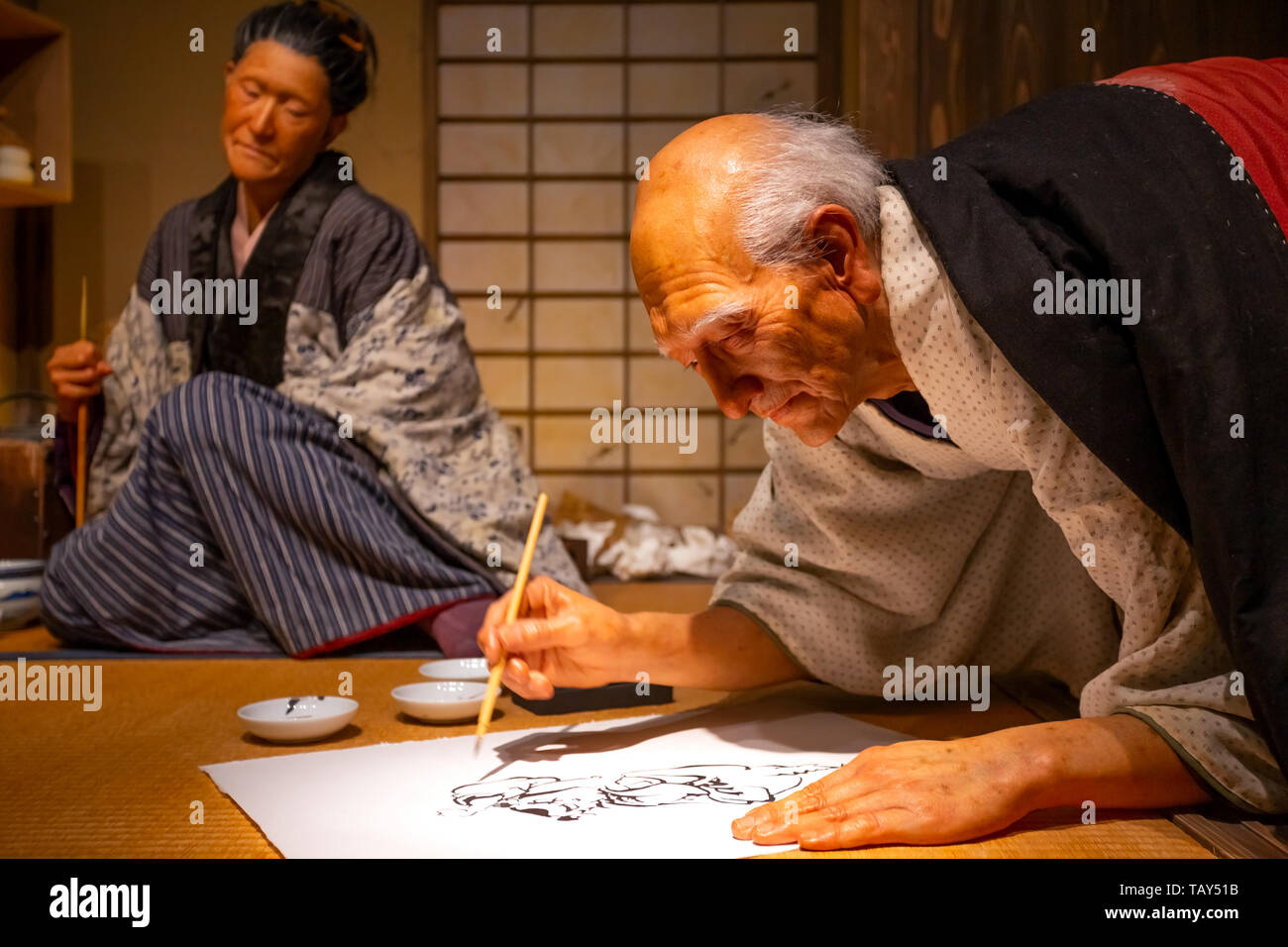 Tokyo, Japan - April 25, 2018: View of an animatronic figures of the Ukiyo-e artist (Japanese woodblock prints), Katsushika Hokusai and his daughter O - Stock Image