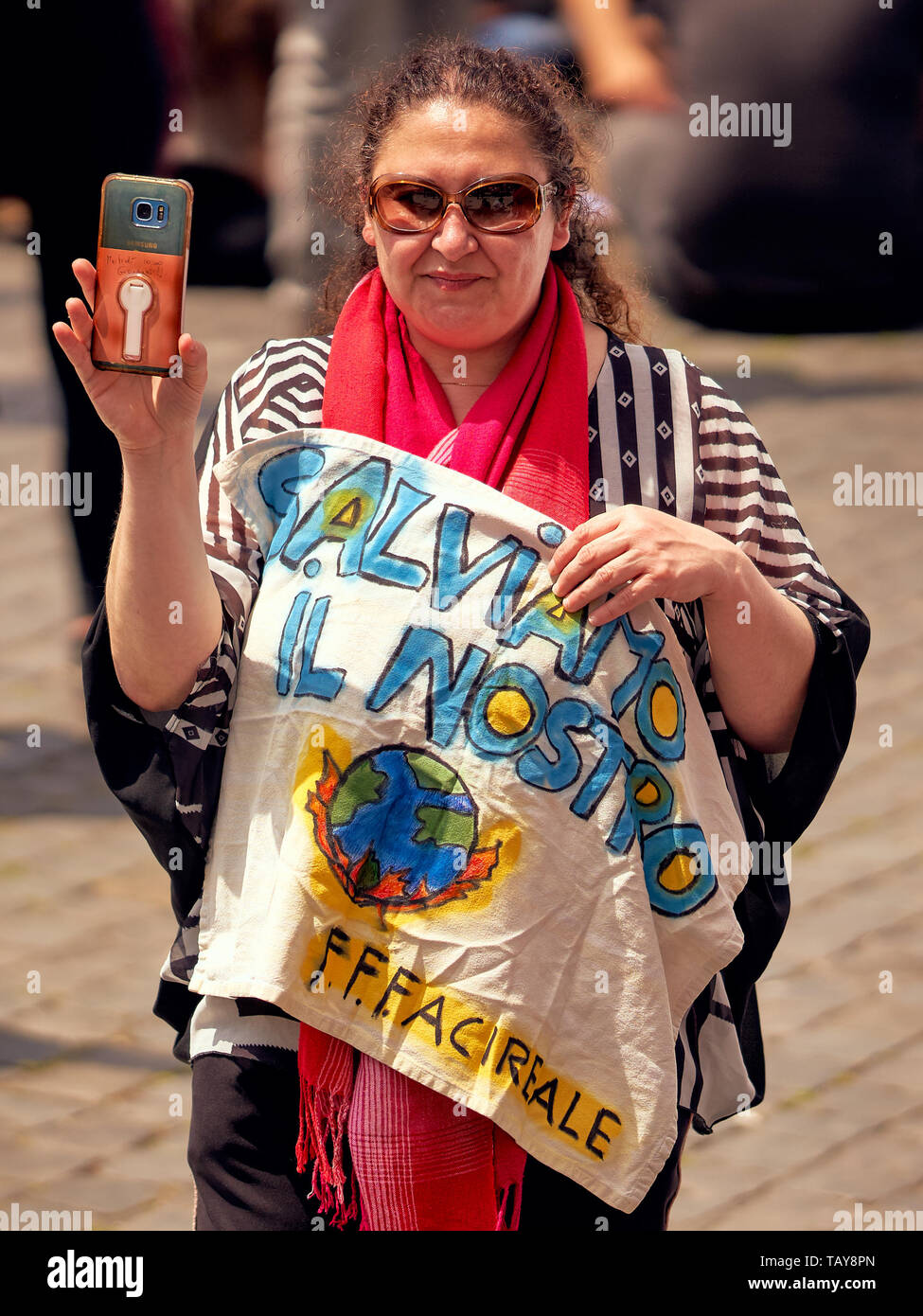 ROME, ITALY - May 24, 2019: Old lady protesting at Global Strike for Future, Fridays for Future near the Colosseum. Funny writing on her phone cover - Stock Image