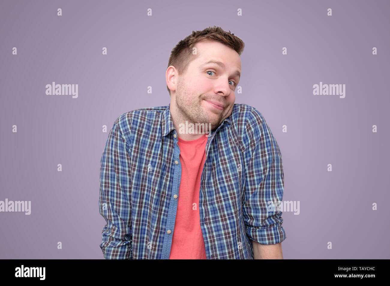 guy showing I have no idea gesture, shrugging shoulders and raising hands - Stock Image