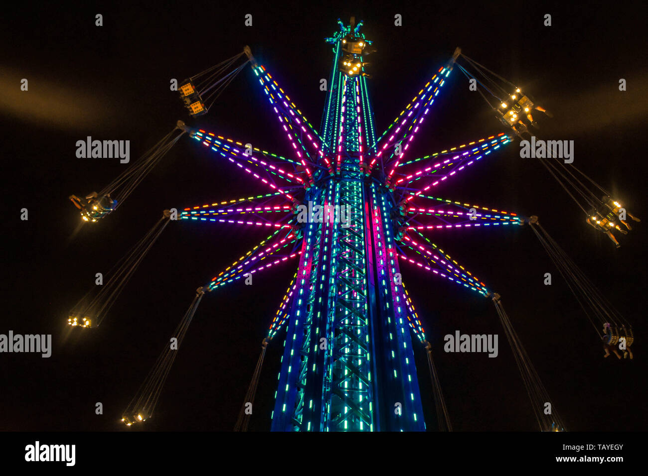 Orlando, Florida. January 19 , 2019 Child estatuel in  Star Flyer attraction and partial view of Orlando Eye in International Drive area (2) Stock Photo