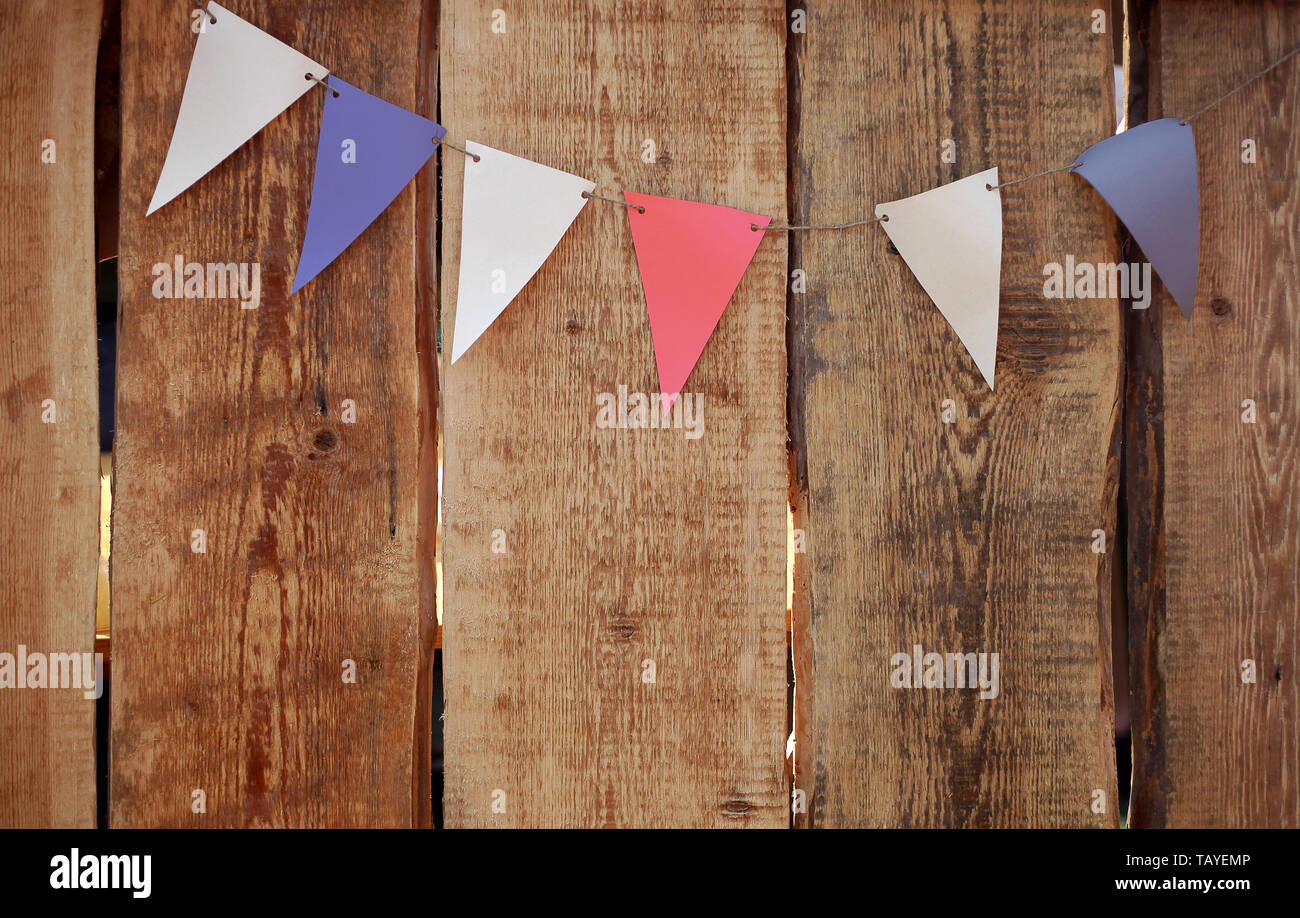 Festive colorful flags against the wooden grunge background. Independance Day in USA, 4th of July. - Stock Image