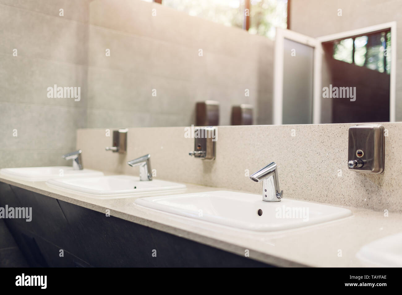 Modern Interior Design In Public Toilet New Sinks Taps With Mirror And Window Above Wc Stock Photo Alamy
