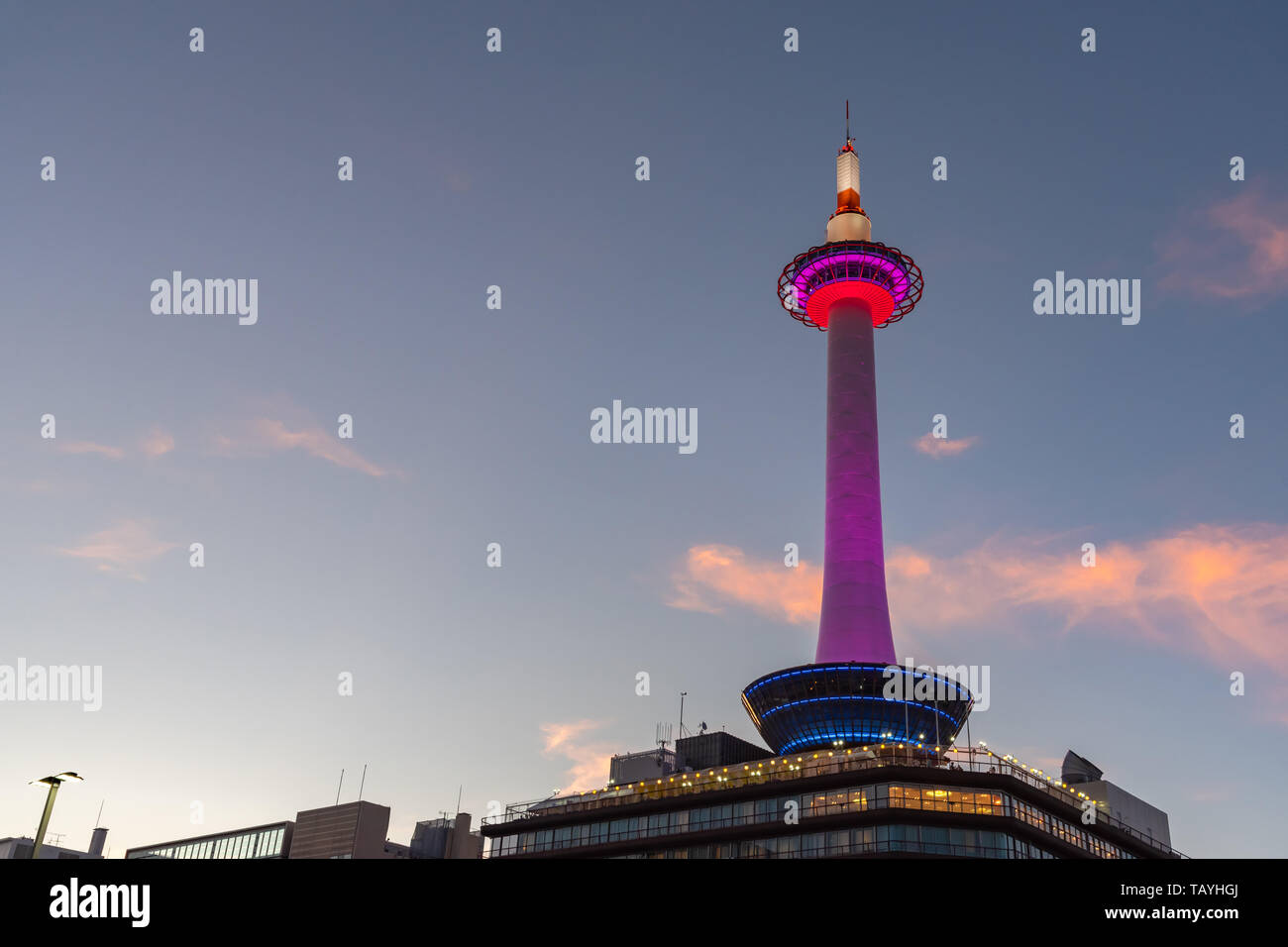 Colorful Kyoto Tower with Kyoto city skyline view at dusk in Japan Stock Photo