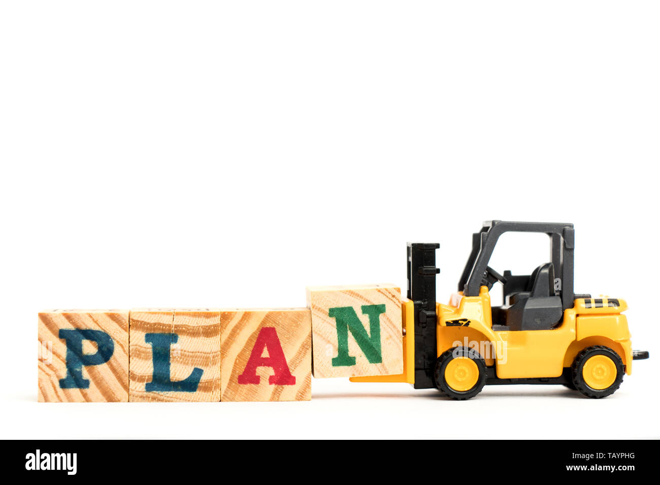 Toy forklift hold letter block N to complete word plan on white background - Stock Image