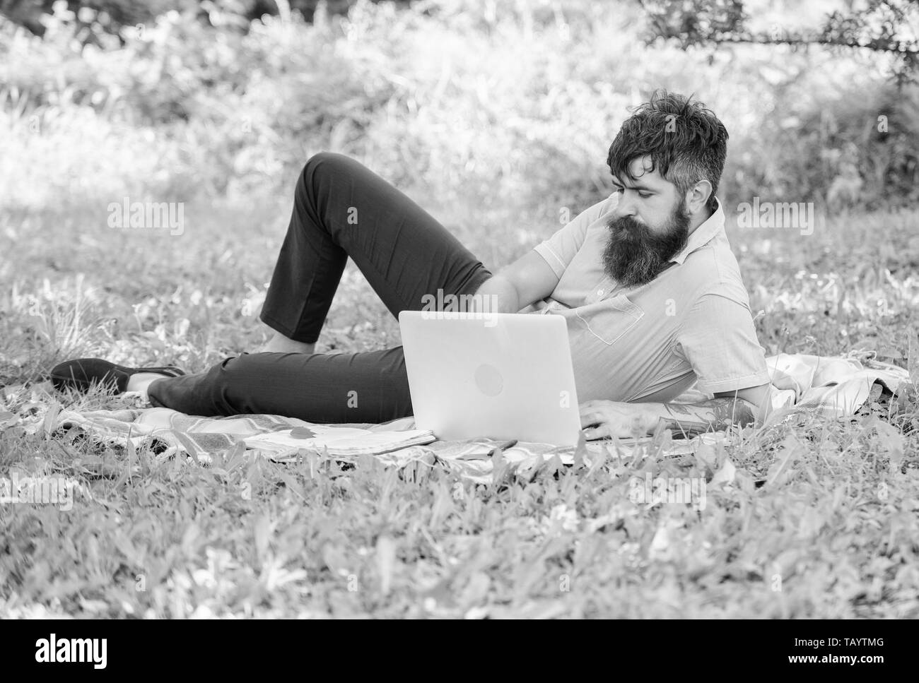 Man bearded with laptop relaxing meadow nature background. Writer looking for inspiration nature environment. Inspiration for blogging. Blogger becoming inspired by nature. Looking for inspiration. - Stock Image