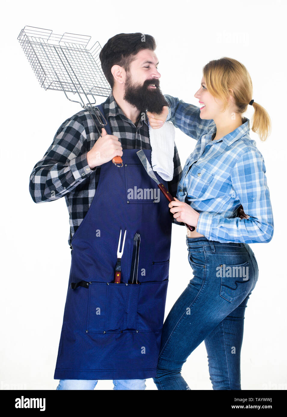 Tools for roasting meat. Family weekend. Man bearded hipster and girl. Preparation and culinary. Couple in love hold kitchen utensils. Picnic barbecue. food cooking. Barbecuing meat to perfection. - Stock Image
