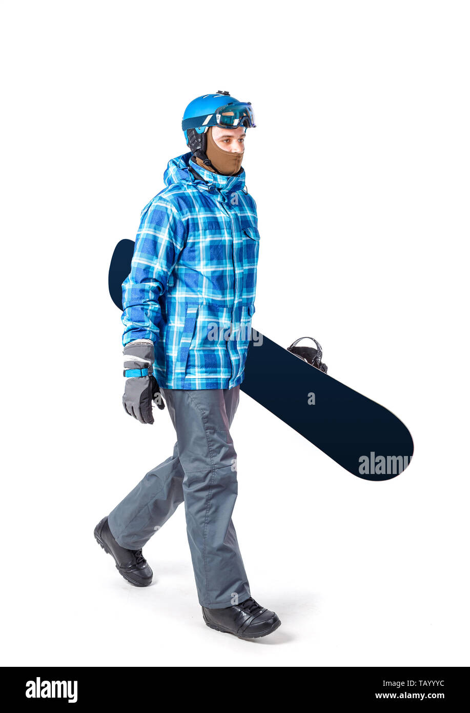 Portrait of young man in sportswear with snowboard isolated on a white background. - Stock Image