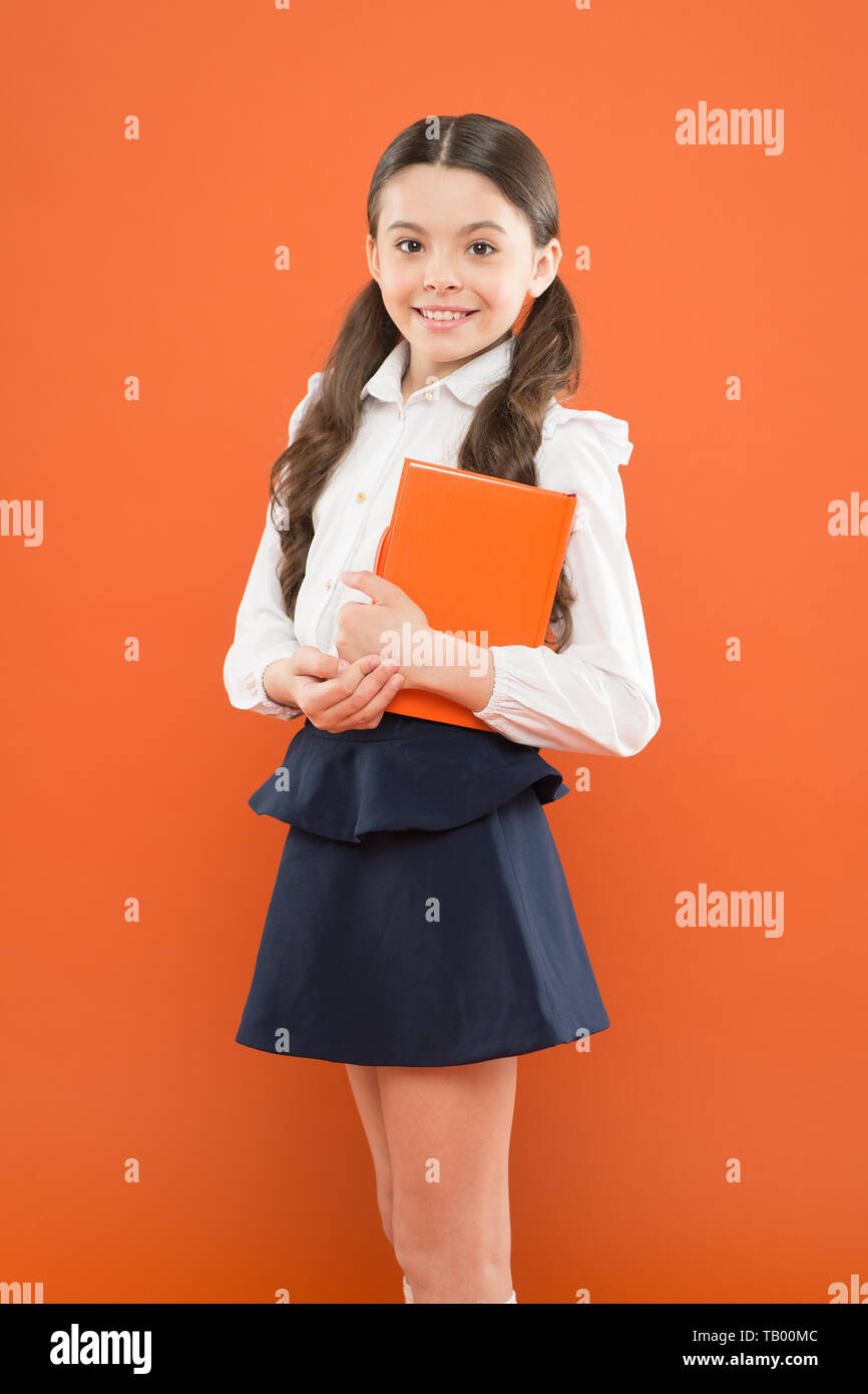 Schoolgirl enjoy study. Kid school uniform hold workbook. School lesson. Child doing homework. Believe in possibilities. Inspiration for study. Back to school. Knowledge day. Possible everything. - Stock Image