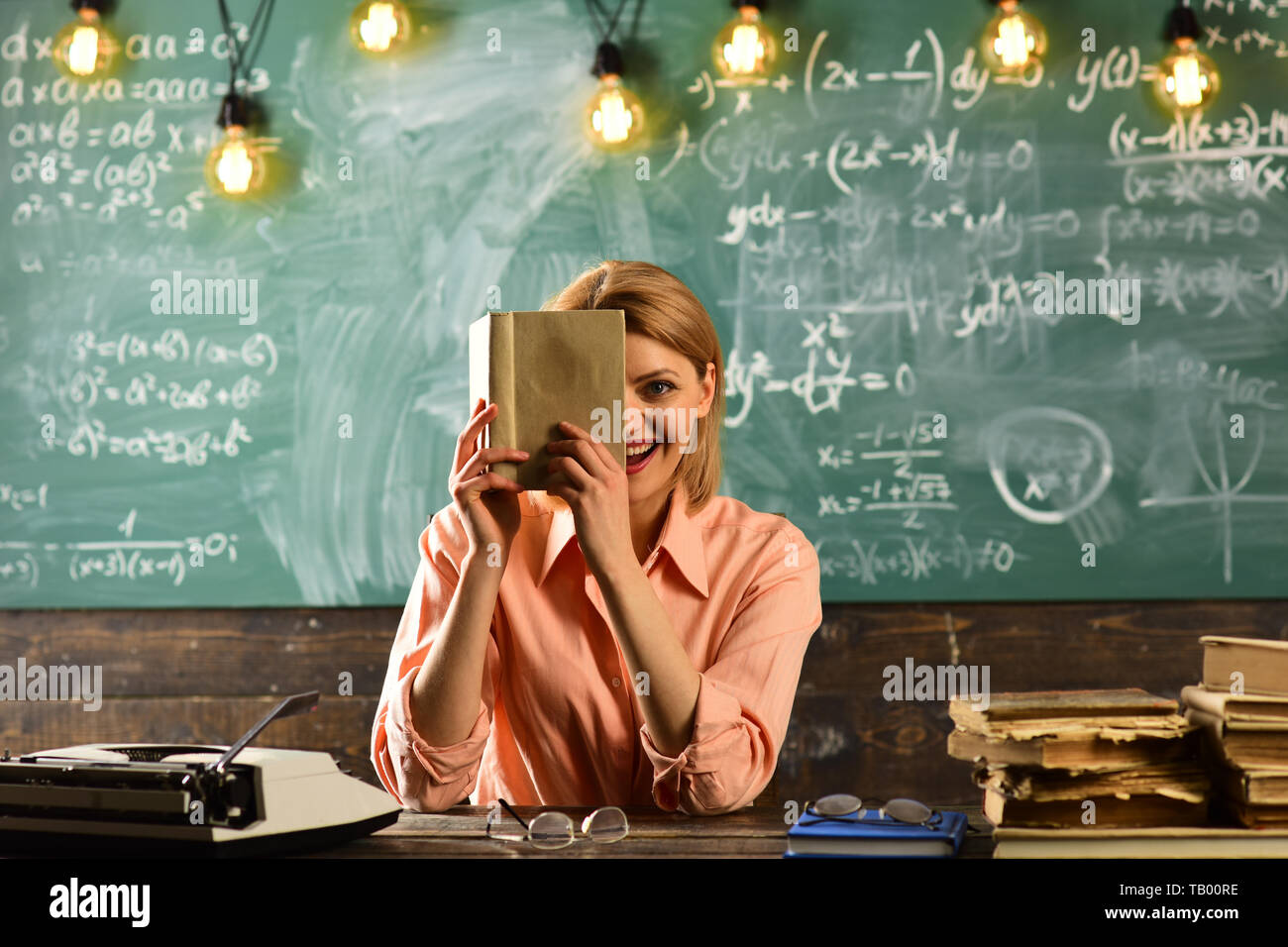 publicist woman hold book at school. publicist search information in book - Stock Image