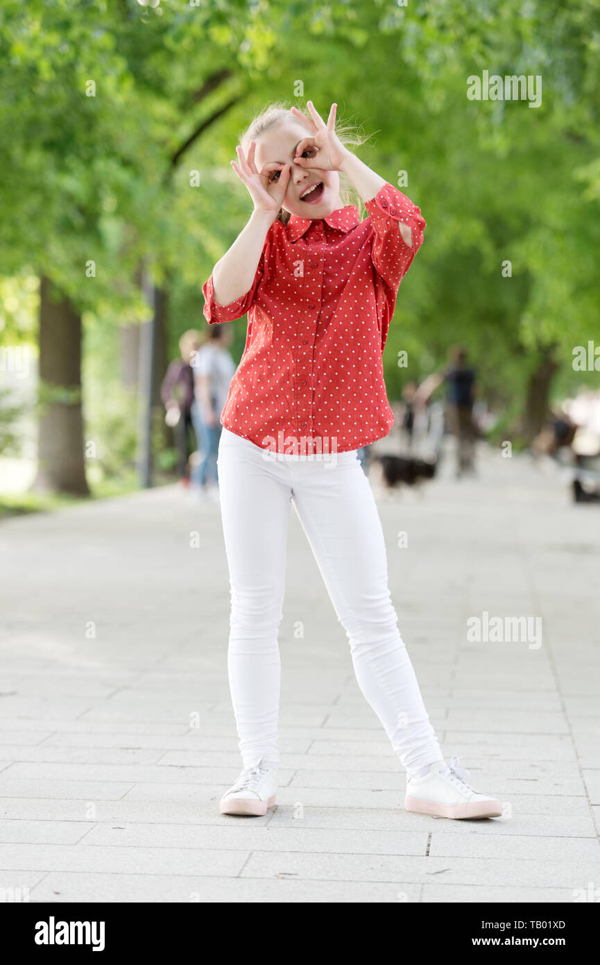 Time to fun. Little child have fun doing glasses gesture outdoor. Small girl enjoying summer fun. Fun activities that make her happy and cheerful. - Stock Image