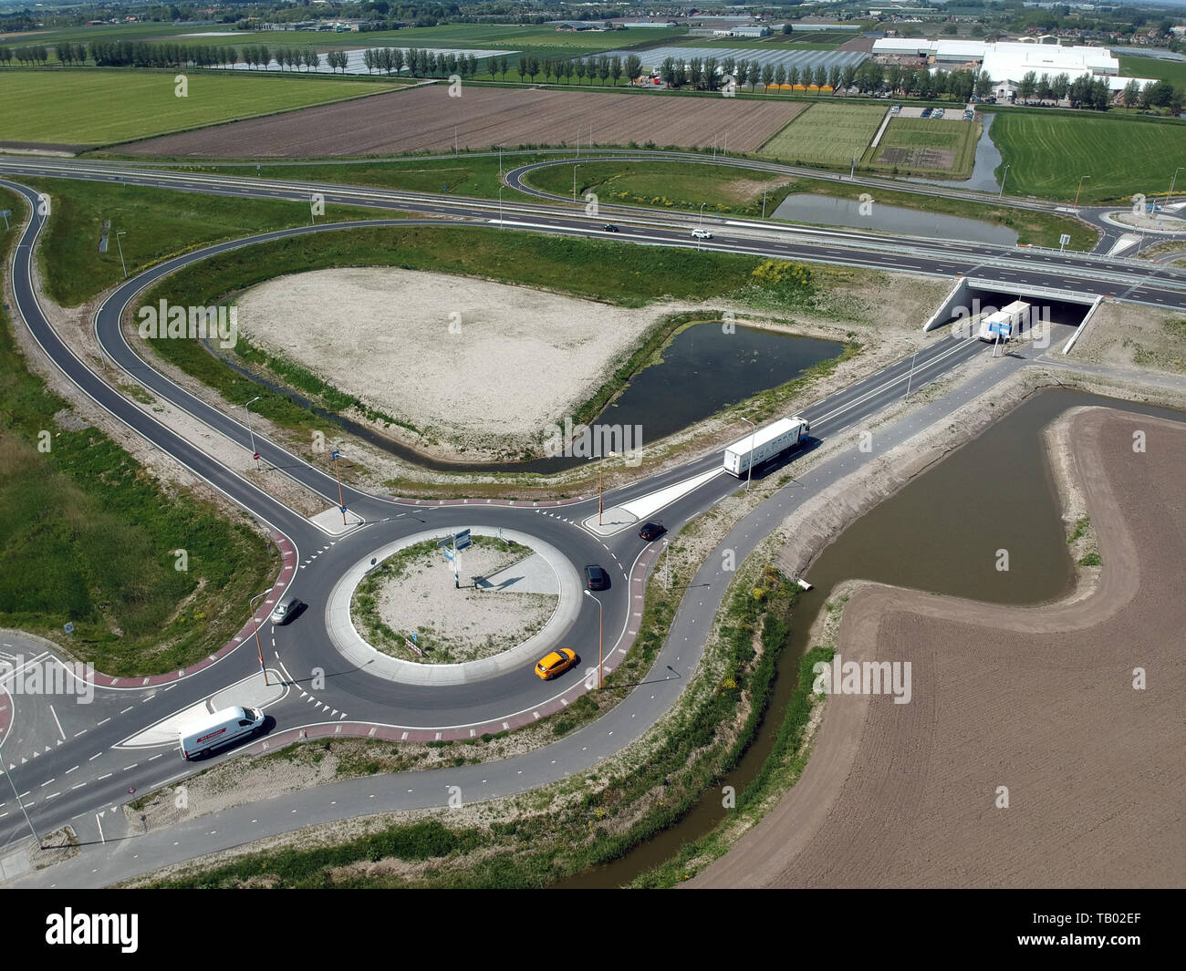 GROOTEBROEK, THE NETHERLANDS -  10 MEI 2019: Drone aerial photo of a traffic circle with on and off roads for the cars - Stock Image
