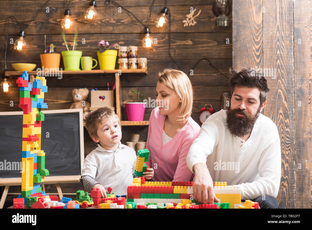 Daycare concept. Little child play daycare game with mother and father. Daycare preschool. Family daycare Stock Photo