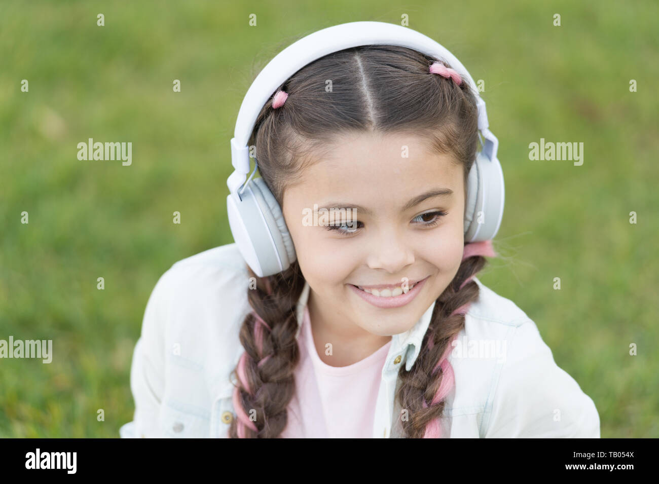 Audio tour headphones gadget. Free style of travelling. Exciting journeys through cities and museums. City guide and audio tour. Girl little tourist kid using audio guide mobile application. - Stock Image