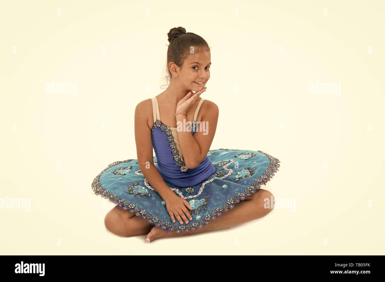 9976dc543263f Kid blue dress with ballet skirt white background isolated. Child flexible  pupil practice dancing.