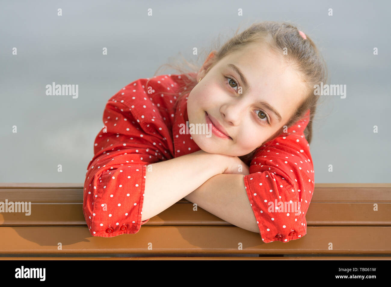 Bringing beauty outside with skincare. Beauty look of little skincare model. Adorable small girl with healthy young face skin. Childrens skincare products and cosmetics. Skincare concept. - Stock Image