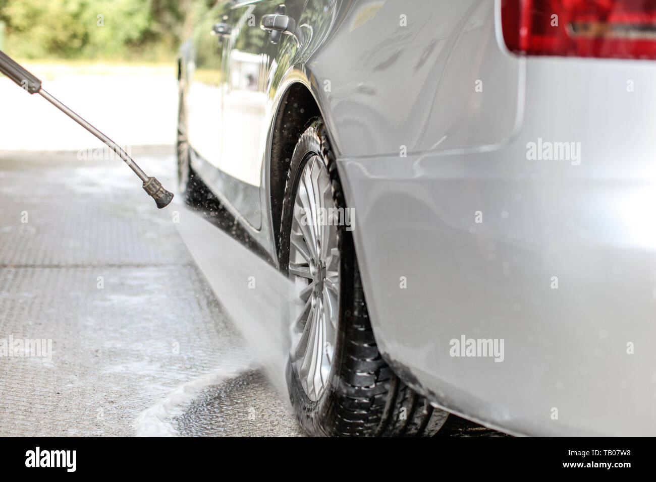 Water Nozzle Spraying Car Wash Stock Photos & Water Nozzle