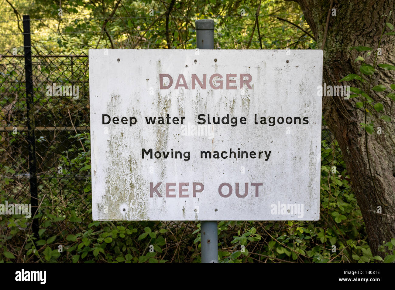 ,Danger Deep Water Sludge Lagoons  Safety Notice Observed at Cromford Sewage Plant,Derbyshire.England - Stock Image