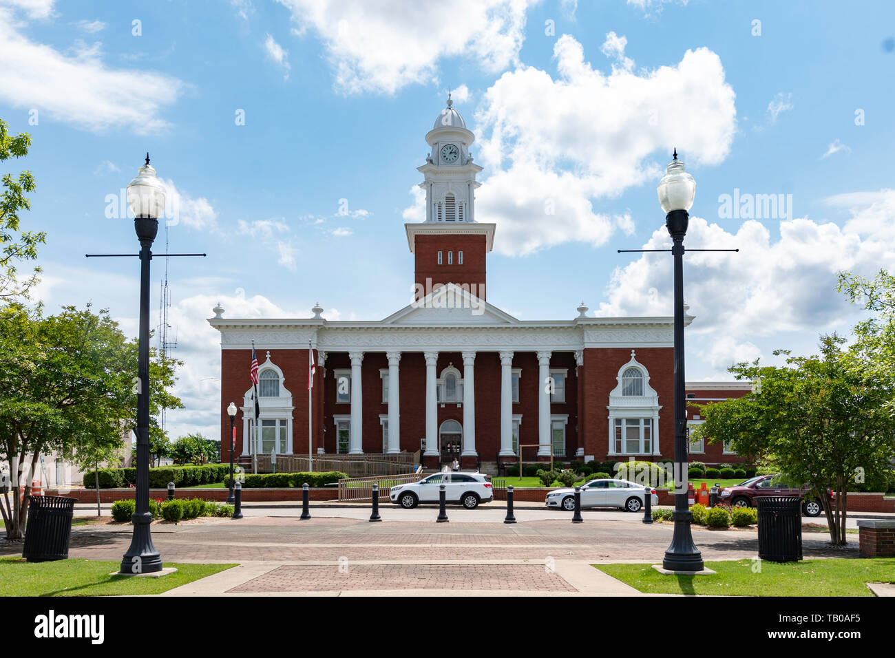 Opelika, Alabama/USA- May 10, 2019:  Historic Lee County Courthouse constructed in 1896 is a two-story, brick building of the Neoclassical architectur - Stock Image