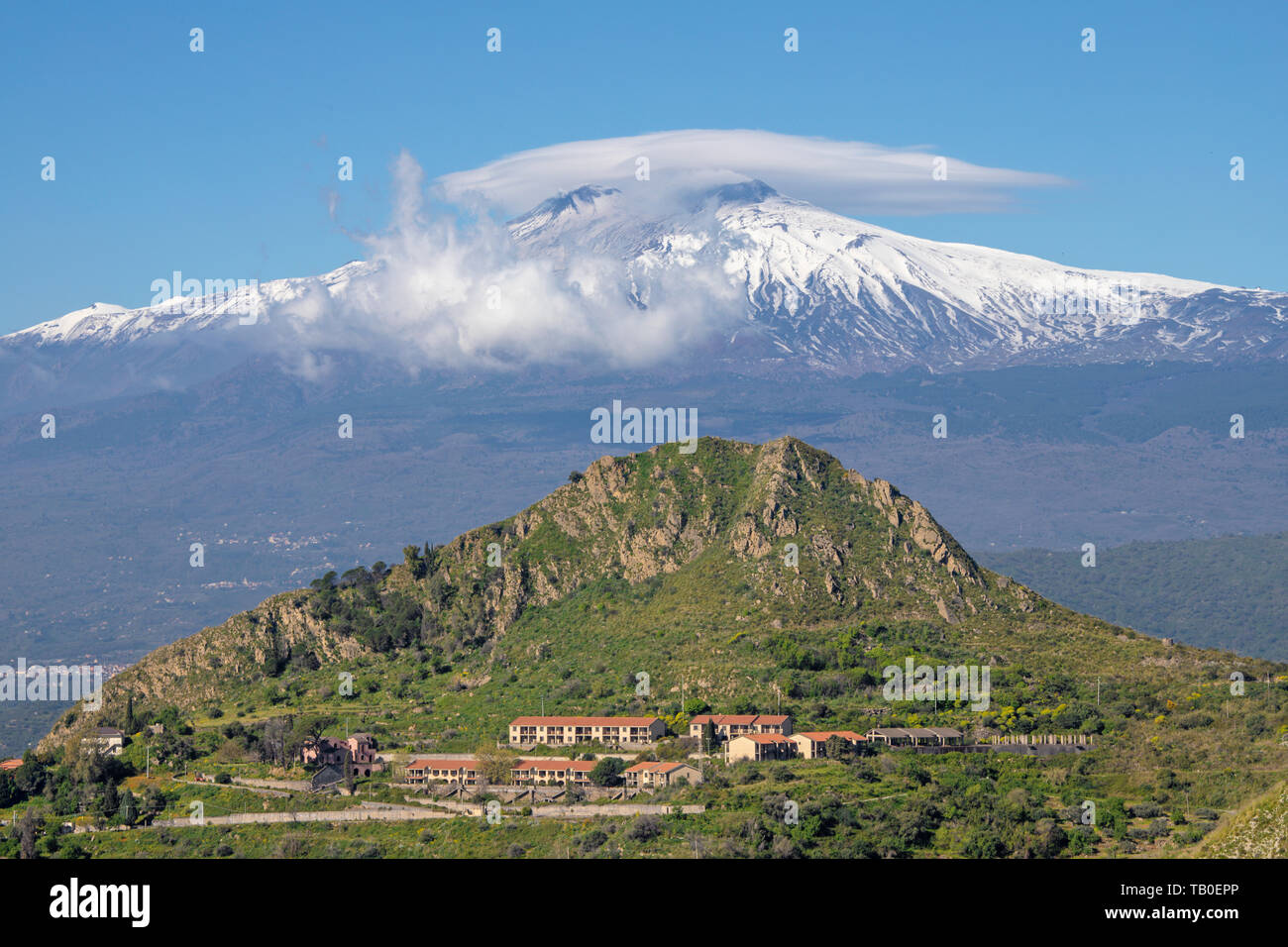 Taormina - The Mt. Etna volcano over the Sicilian landscape. - Stock Image