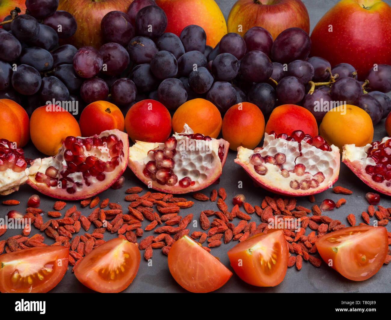 Red Fruits And Berrys Rich Vitamin Resveratrol Antioxidants Food Apples Grape Apricots Pomegranate Goji Tomatoes Stock Photo Alamy