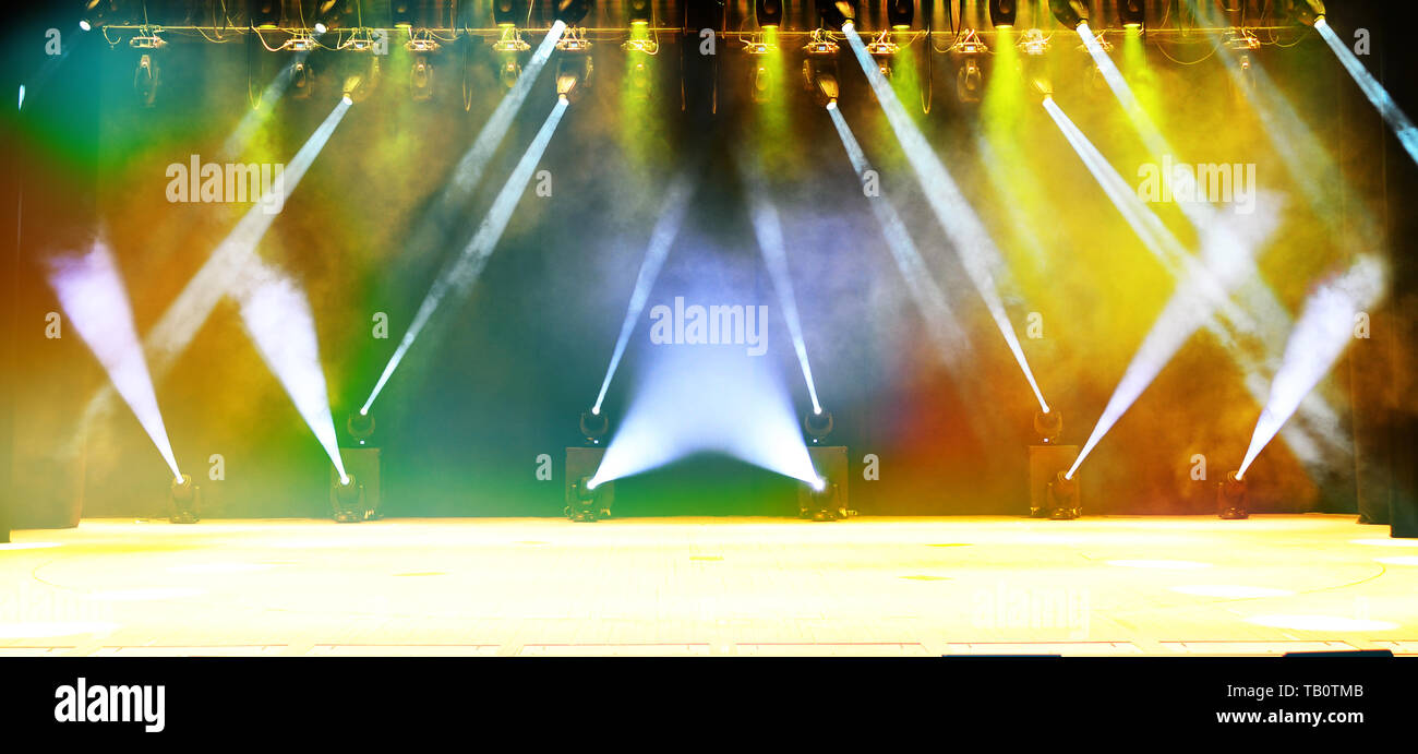 Illuminated empty concert stage with haze and rays of