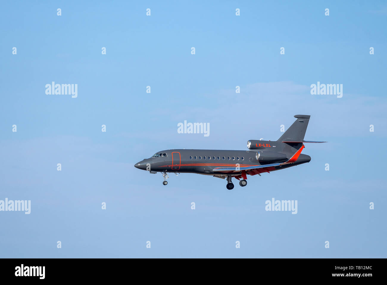 Munich, Germany - February 28. 2019 : Global Jet Luxembourg Dassault Falcon-900LX with the aircraft registration LX-LXL in the approach to the norther - Stock Image