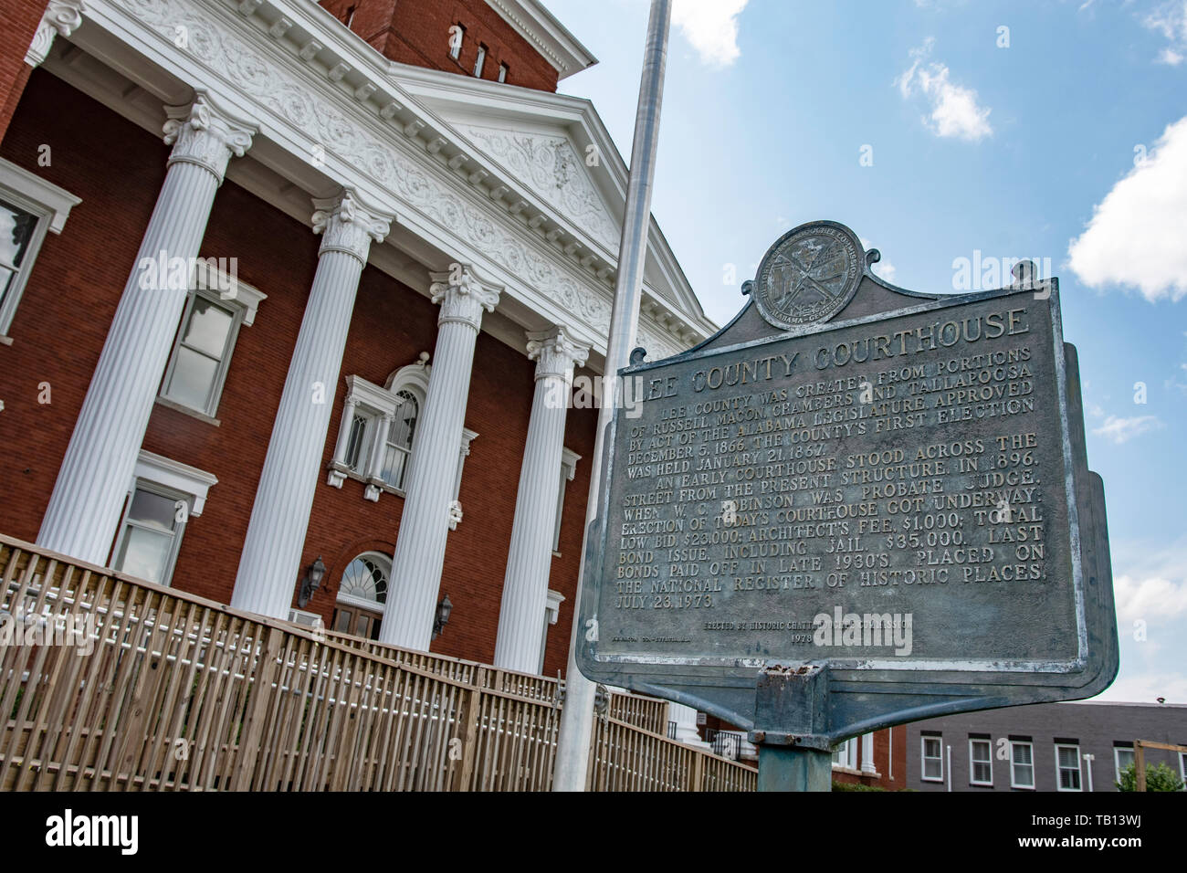 Opelika, Alabama/USA- May 10, 2019:  Historic marker in front of the Lee County Courthouse shot at a dutch tilt. - Stock Image