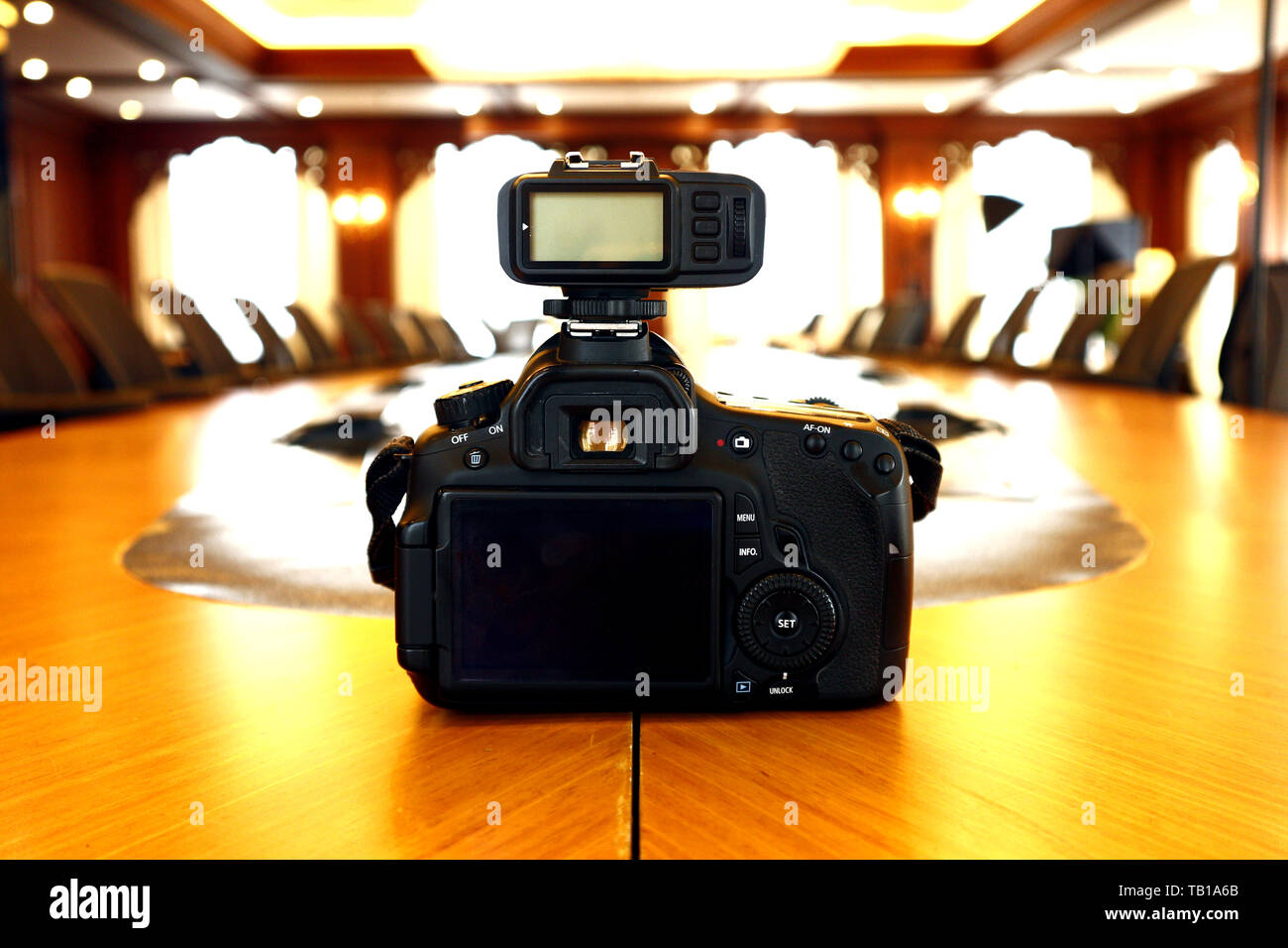Photo of a Digital Single Lens Reflex Camera on a boardroom table - Stock Image